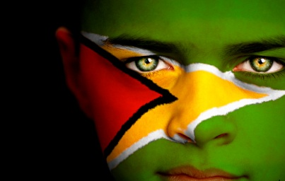 child with Guyana Flag painted on face